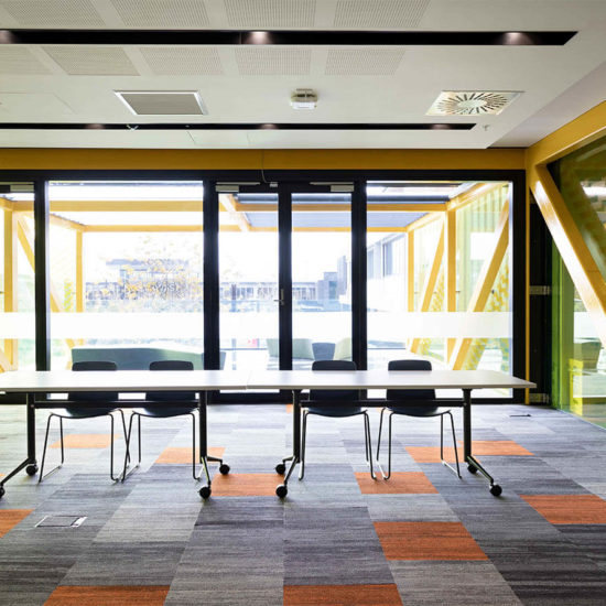 white and black flip tables in community room