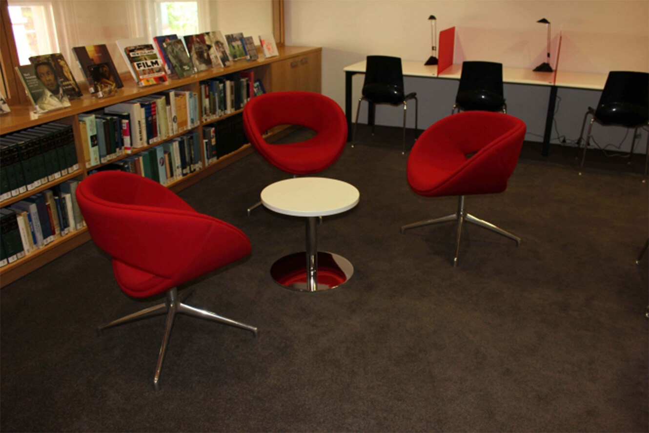 red occassional chairs with white table
