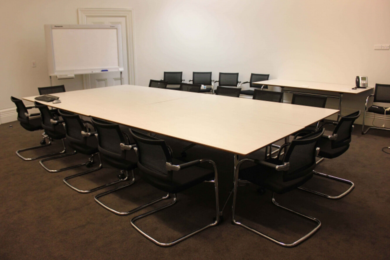 Boardroom table with black mesh chairs
