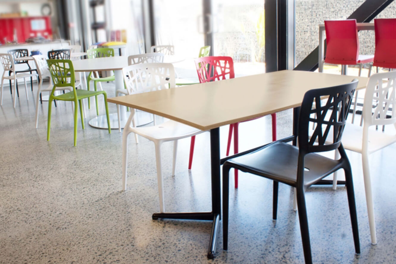 Cafe tabel with green, black, white and red chairs