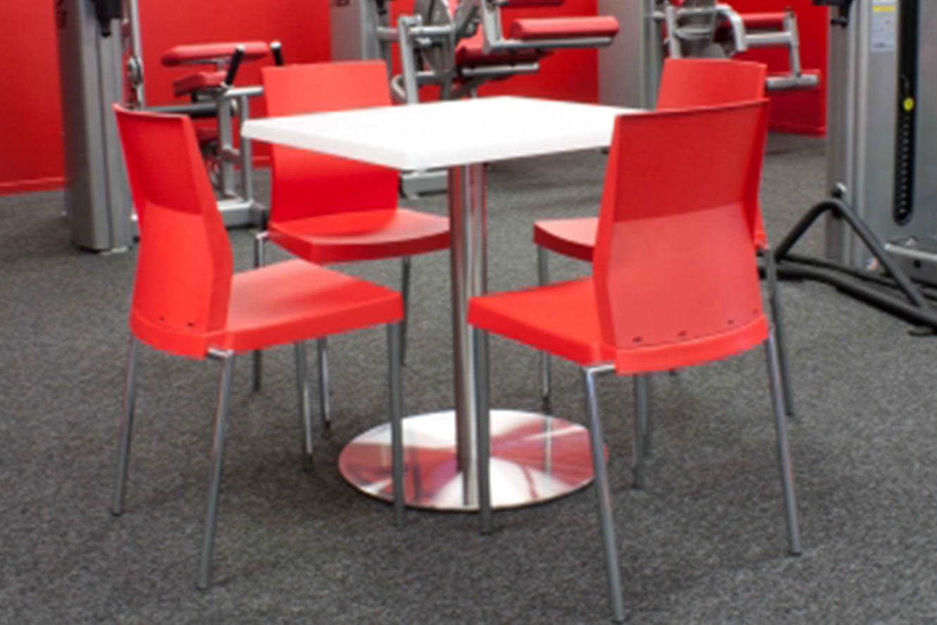 table with red chairs