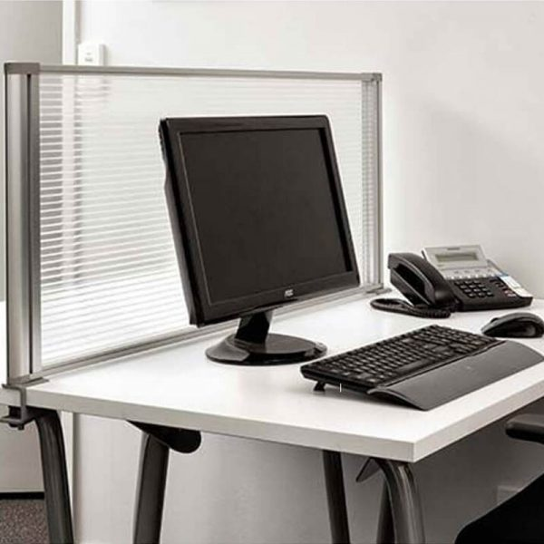 Polycarbonate screen attached to desk